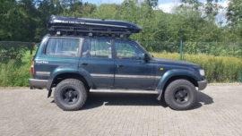 Toyota Land Cruiser Dachbox Toyota Box portabagagli Malibu con barre porta surf sul coperchio
